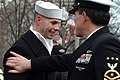 US Navy 050120-N-0962S-063 Master Chief Petty Officer of the Navy (MCPON) Terry Scott gives a congratulatory pat on the shoulder to one of the hundreds of Sailors who helped line the street cordon down Pennsylvania Avenue for t.jpg