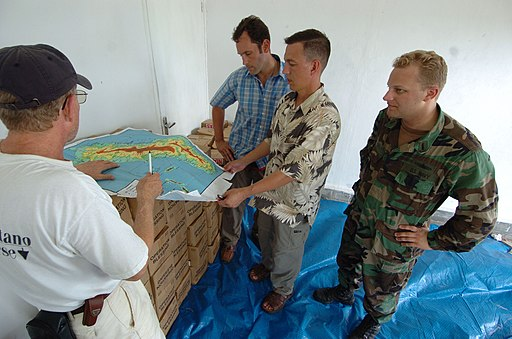 US Navy 050406-N-8629M-065 A member of Samaritan's Purse International Relief Organization shares a map of Nias, Indonesia