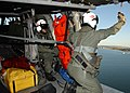 US Navy 050427-N-9500T-111 Aviation Structural Mechanic 3rd Class Luigi Caprio operates the rescue hoist.jpg