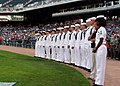 US Navy 050721-N-3342W-004 Personnelman 1st Class Tongela Wingard, far right, assigned to Naval Recruiting District Michigan, sings the national anthem prior to a U.S. Navy Night at Comerica Park.jpg