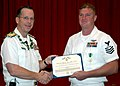 US Navy 060120-N-3019M-001 Chief of Naval Operations (CNO) Adm. Mike Mullen presents a Navy ^ Marine Corps Commendation Medal to Aviation Structural Mechanic 1st Class Larry D. Cummins.jpg