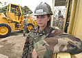 US Navy 060419-N-2385R-052 Equipment Operator Constructionman Apprentice Raymie Huddleston assigned to Naval Mobile Construction Battalion Four (NMCB-4), stands by on a project site.jpg