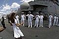 US Navy 060524-N-7676W-146 Amphibious assault ship USS Kearsarge (LHD 3) Command Master Chief Joseph V. Schnurbusch greets actress Halle Berry on the ship's flight deck.jpg