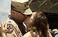 US Navy 060607-F-5853M-027 Lt. Cliff Uddenberg is greeted by his wife, Julie after returning from deployment.jpg