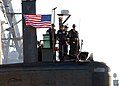 US Navy 070106-N-5268S-002 Commanding Officer Wesley Guinn, USS Scranton (SSN 756) mans the bridge as Scranton pulls out for a scheduled deployment in support of the Bataan Expeditionary Strike group.jpg