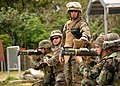 US Navy 070406-N-0775Y-110 Range Safety Officer, Gunnery Sgt. Chad McKee, a Marine attached to Naval Mobile Construction Battalion (NMCB) 3 prepares to give Seabees the order to fire two Anti Tank Rocket (AT4) launchers.jpg