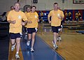 US Navy 070627-N-8053S-008 Senior enlisted leaders attending the Master Chief Petty Officer of the Navy's (MCPON) Leadership Mess Meeting participate in a jog around the gymnasium.jpg