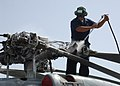 US Navy 070809-N-8560S-003 AE2 Tyrone Reilly of Helicopter Anti-Submarine Squadron 43 embarked aboard USS Chung-Hoon (DDG 93), washes the propeller of a SH-60B Seahawk helicopter.jpg