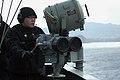 US Navy 080215-N-6516T-024 Operations Specialist Seaman Danny Aldana keeps watch with.jpg