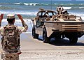US Navy 080630-N-1424C-008 Seabees assigned to Beach Master Unit (BMU) 1 guide a Lighter Amphibious Re-supply Cargo (LARC) from the surf.jpg