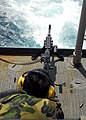 US Navy 080725-N-4236E-006 Gunner's Mate 2nd Class Dian Jiang shoots an M240B machine gun off the fantail of the guided-missile cruiser USS Vella Gulf (CG 72). Vella Gulf is participating in Joint Task Force Exercise (JTFEX) 08.jpg