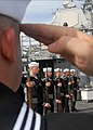 US Navy 080805-N-9758L-276 An honor guard detail performs a rifle salute during a burial at sea ceremony.jpg