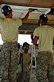 US Navy 081111-N-4515N-077 Air Force engineers hang lighting fixtures.jpg