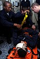 US Navy 081113-N-9758L-024 Sailors assigned to the Pearl Harbor-based Arleigh Burke-class guided-missile destroyer USS Paul Hamilton (DDG 60) strap down Yeoman Seaman Laquann Vines to a stretcher during a medical casualty drill.jpg