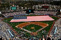 US Navy 090413-N-9706M-124 Sailors and Marines unfurl a football field-sized American flag at Dodger Stadium during the pre-game activities before a Major League Baseball game between the Los Angeles Dodgers and the San Francis.jpg