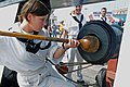 US Navy 090915-N-9824T-227 Seaman Sarah Rickett, assigned to USS Constitution, demonstrates how Sailors in the past would prepare a cannon for firing.jpg