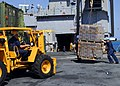 US Navy 100124-N-5244H-026 Sailors assigned to the amphibious dock landing ship USS Carter Hall (LSD 50) take on pallets of Meals-Ready-to-Eat.jpg