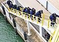 US Navy 100708-N-7643B-151 U.S. Coast Guardsmen, assigned to the U.S. Coast Guard cutter Mellon (WHEC 717), move up a ladder.jpg