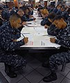 US Navy 100909-N-2344B-040 Third class petty officers take the semi-annual advancement exam on the aft mess deck of the aircraft carrier USS Ronald.jpg