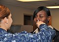 US Navy 100914-N-8361C-016 A staff member at Naval Medical Center Portsmouth receives a dose of FluMist, the nasal influenza vaccination.jpg