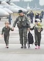 US Navy 101026-N-2858S-206 Cmdr. William Gotten, executive officer of the Dambusters of Strike Fighter Squadron (VFA) 195, walks with his son and d.jpg