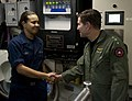 US Navy 101214-N-7981E-188 Vice Adm. Allen G. Myers meets Hull Technician Fireman Jesseca Crosby while touring the waste processing room aboard USS.jpg