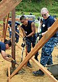 US Navy 110201-N-4630B-007 Sailors pour cement for footers for a structure during a community service event for Habitat for Humanity.jpg