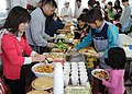 US Navy 110327-N-MU720-043 Volunteers from Naval Air Facility Misawa and Misawa Air Base serve a home cooked meal to children and staff members at.jpg