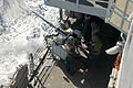 US Navy 110404-N-NL541-018 Sailors fire an MK 38 25 mm mounted gun during a practice fire aboard USS Boone (FFG 28).jpg