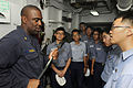 US Navy 110818-N-XG305-553 Chief Damage Controlman Ernest Thomas explains how to use a halogen tool for overhauling a fire to Republic of Korea sai.jpg
