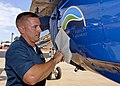 US Navy 110831-N-DI587-003 A Sailor applies a Navy Energy Security logo to a Blue Angels F-A-18.jpg