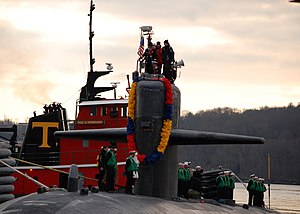 US Navy 111214-N-AW342-030 The Los Angeles-class submarine USS Dallas (SSN 700) is tugged to the pier at Naval Submarine Base New London after a sc.jpg