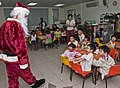 US Navy 111222-N-DX615-057 Chief Warrant Officer Marc Lefebvre, dressed as Santa Claus, greets children at Singapore's Child at Street 11 care cent.jpg