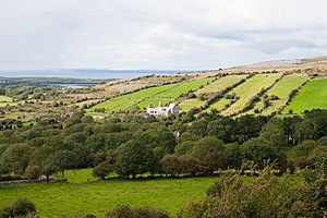 Corcomroe Abbey - View of Corcomroe from Oughtmama with Galway Bay in the background
