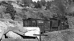Uintah Railway primarily hauled Gilsonite but here dinosaur bones peak-out from under a tarp enroute to Mack, CO for shipment to the Carnegie Museum.jpg