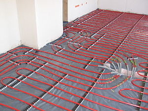 Underfloor heating pipes, before they are cove...