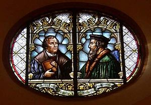 Religion in Germany - Glass window in the town church of Wiesloch with Martin Luther and John Calvin commemorating the 1821 union of Lutheran and Reformed churches in the Grand Duchy of Baden. The idea of church union originated in the early 19th-century Germany and later spread worldwide.