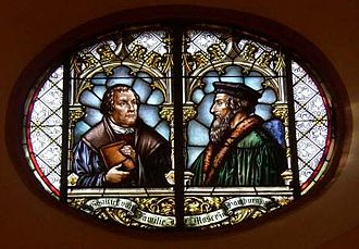 United and uniting churches - Glass window in the town church of Wiesloch (Stadtkirche Wiesloch) with Martin Luther and John Calvin commemorating the 1821 union of Lutheran and Reformed churches in the Grand Duchy of Baden.