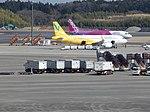 Vanilla and Peach A320s at NRT (16605246309).jpg