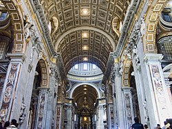 St. Peter's Basilica VATICAN. This photo of the interior reveals the near details of the arched ceiling which is divided into square coffers. The changes that Maderno made to the axis and width can be seen clearly in this picture.
