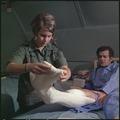 Vietnam. 1st Lt. Elaine H. Niggemann changes a surgical dressing for Mr. James J. Torgelson at the 24th Evacuation... - NARA - 530630.tif