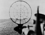 View through a gunsight of USS Phoenix (CL-46) off Leyte on 21 October 1944 (80-G-291377).jpg