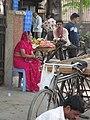 Village woman seeing the city - panoramio.jpg