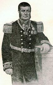 Engraved, three-quarters-length portrait of a man with dark hair and sideburns leaning against a plinth and dressed in an elaborately embroidered naval uniform with a double-breasted tunic adorned with epaulettes and medals