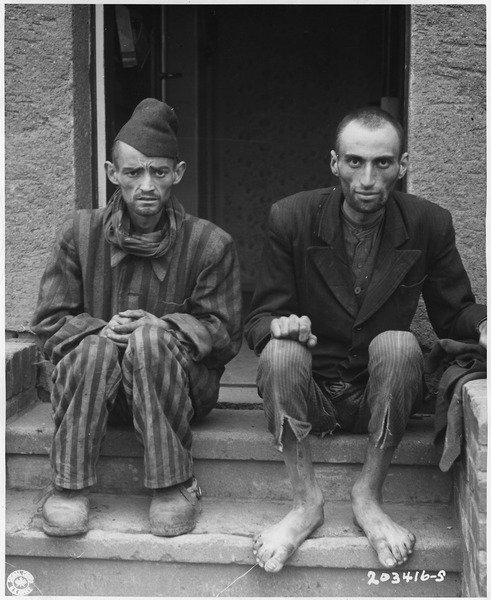 """Datei:WWII Europe, Germany, Concentration Camps, """"Two men sitting after liberation from Lager-Norhausen Death Camp"""" - NARA - 196311.tif"""