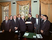 Warren Commission presenting report on assassination of John F. Kennedy to Lyndon Johnson