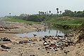 Water pollution due to domestic garbage at a channel near VUDA Park beach.jpg