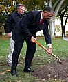 White House Chief Usher Rear Admiral Stephen W. Rochon (Ret.), , along with Grounds Superintendent Dale Haney, participates in a commemorative tree planting ceremony on the North Grounds of the White House.jpg