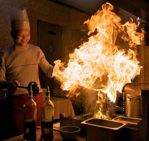 Chef cooking with fire at Beerse, Antwerp, Belgium.