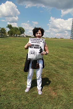 Woman peace activist from Pittsburgh with sign - Fund Jobs Not Wars - 50th Anniversary of the March on Washington for Jobs and Freedom
